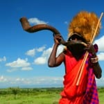 Masai warrior playing traditional horn. Africa. Kenya