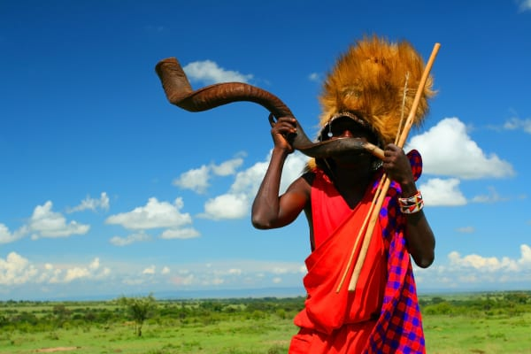 Masai-warrior-playing-traditional-horn.-